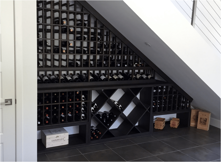 Under the stairs New Jersey wine cellar after completion